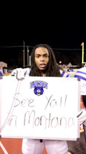 University of Central Arkansas' Rojae Jackson holds up a sign for UCA fans after the Bears' 34-14 win Saturday over Tennessee Tech in the NCAA Division I Football Championship Subdivision playoffs. As Jackson's sign indicates, UCA will play at Montana next week. DAVID MCCOLLUM PHOTO
