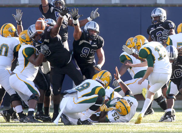 Old Dominion University players block a field goal attempt by Norfolk State University's Ryan Estep on Saturday, Nov. 26, 2011. (Ross Taylor | The Virginian-Pilot)