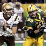 Lehigh quarterback Chris Lum, left, tries to escape pressure applied by North Dakota State's Cole Jirik while Mountain Hawks' Matt Lippincott of Wilson tries to pass protect. (Dave Wallis/InForum via the Express-Times)