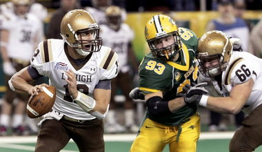 Lehigh quarterback Chris Lum, left, tries to escape pressure applied by North Dakota State's Cole Jirik while Mountain Hawks' Matt Lippincott of Wilson tries to pass protect. (Dave Wallis/InForum via the Express-Times)