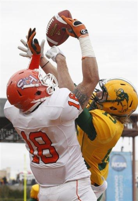 Sam Houston State wide receiver Trey Diller (18) and North Dakota State safety John Pike (15) jump for a pass during the first half of the FCS championship NCAA college football game Saturday, Jan. 7, 2012, in Frisco, Texas. The pass fell incomplete. (AP Photo/LM Otero courtesy of Bison Athletics)