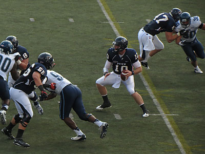 Penn quarterback Billy Ragone surveys the field from the pocket, 9/22/2012