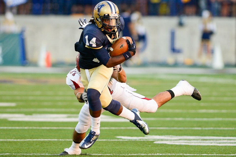 Montana State's Everett Gilbert runs the ball against Chadron State's Bryce Huebner during the first half of their football game at Bobcat Stadium on Thursday, Aug. 30 in Bozeman.