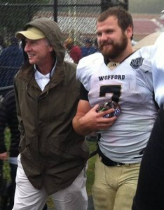Eric Breitenstein walking off the field with an armful of Snickers bars for his offensive linemen Saturday after breaking the Southern Conference single-game record with 321 yards at Elon.