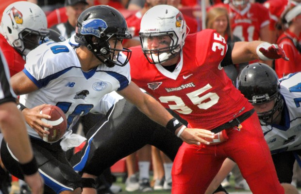 Illinois State University's Colton Underwood (35) closes in for a sack on Eastern Illinois quarterback Jimmy Garoppolo (10), in the first half of play at Hancock Stadium in Normal, Saturday Sept. 15, 2012.