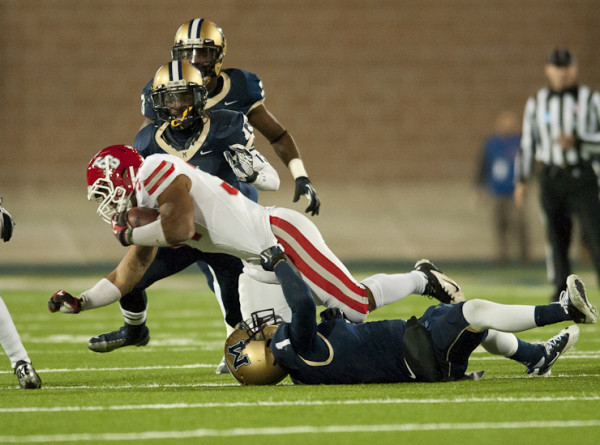 Stony Brook RB Marcus Coker getting tackled on a rush.