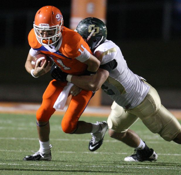 Sam Houston State quarterback Brian Bell (left) is sacked by Cal Poly's Chris Nicholls during the second half of a FCS college football playoff game, Saturday, December 1, 2012 at Bowers Stadium in Huntsville, TX.