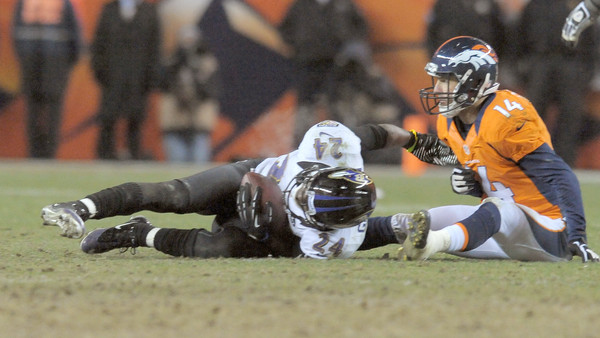 Ravens cornerback Corey Graham, left, intercepts a pass from Denver Broncos quarterback Peyton Manning, setting up the game-winning field goal.