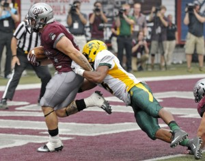 Montana running back Joey Counts runs the game-winning touchdown into the end zone as North Dakota State's Jordan Champion attempts a tackle during the Grizzlies' 38-35 victory on Saturday at Washington-Grizzly Stadium. The Grizzlies came from behind to win with 6 seconds left in the game in front of a record crowd.