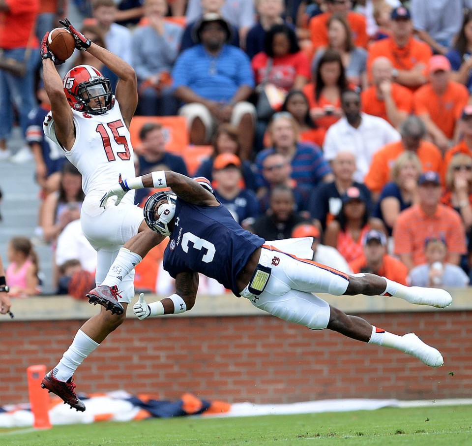 Jacksonville State wide receiver Ruben Gonzalez (15) completes a pass defended by Auburn defensive back Jonathan Jones (3) during first half Saturday, Sept. 12, 2015, at Jordan-Hare Stadium in Auburn, Ala. (Julie Bennett/al.com)