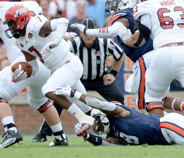 Auburn linebacker Cassanova McKinzy (8) gets a hand on Jacksonville State quarterback Eli Jenkins (7) during first half Saturday, Sept. 12, 2015, at Jordan-Hare Stadium in Auburn, Ala (Julie Bennett/AL.com)