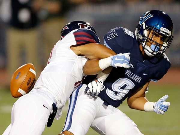 Villanova's Aaron Wells drops the football again Penn's Mason Williams during the first-quarter at Villanova on Thursday, September 24, 2015. ( YONG KIM / Philadelphia Inquirer )