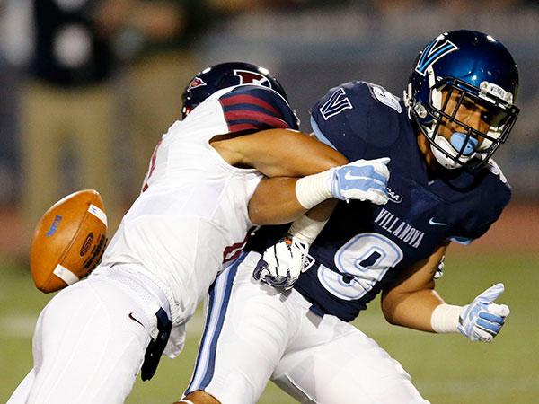 Villanova's Aaron Wells drops the football again Penn's Mason Williams during the first-quarter at Villanova on Thursday, September 24, 2015. ( YONG KIM / Philadelphia Inquirer )