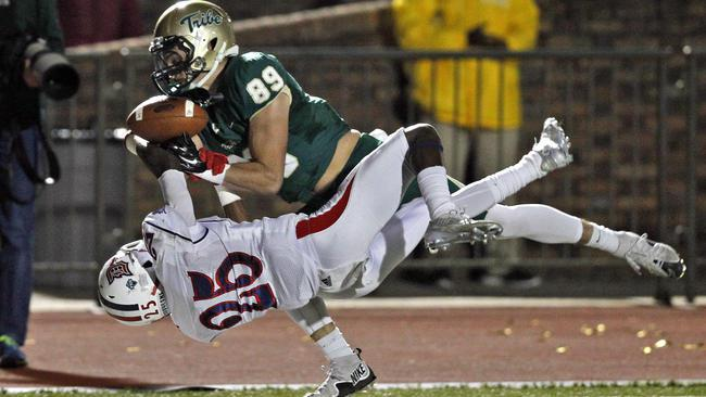 Duquesne DB Josh Jordan tackling William and Mary WR Daniel Kuzjak.