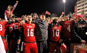 Jacksonville State coach John Grass sings I'll Fly Away with players and fans following the FCS semifinal football game at JSU Stadium in Jacksonville, Ala., Saturday, Dec. 19, 2015. (Dennis Victory/al.com)