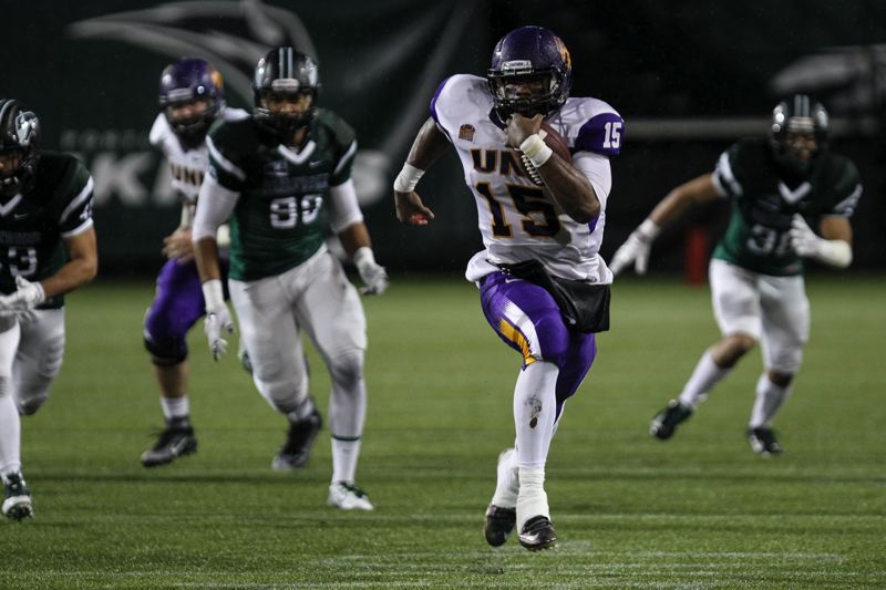 Northern Iowa quarterback Aaron Bailey breaks into the secondary against Portland State. (David Blair/Portland Tribune)