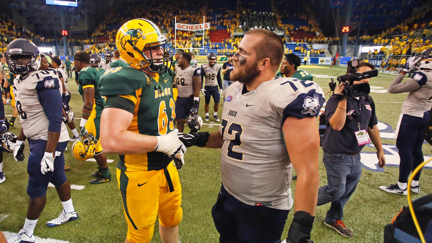 North Dakota State's Aaron Steidl and Charleston Southern's Frank Cirone shake hands after the overtime finish Saturday, August 27, 2016, at the Fargodome. (David Samson / The Forum)