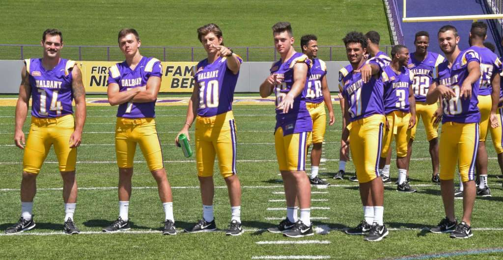 Quaterbacks mug for photos during UAlbany football media day at Casey Stadium Tuesday Aug. 9 (Albany Times-Union)