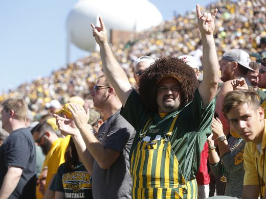 A North Dakota State fan cheers in the stands after an early touchdown against Iowa Saturday, Sept. 17, 2016 during the Hawkeyes' 23-21 loss to the Bison at Kinnick Stadium in Iowa City.  (Michael Zamora/The Register)