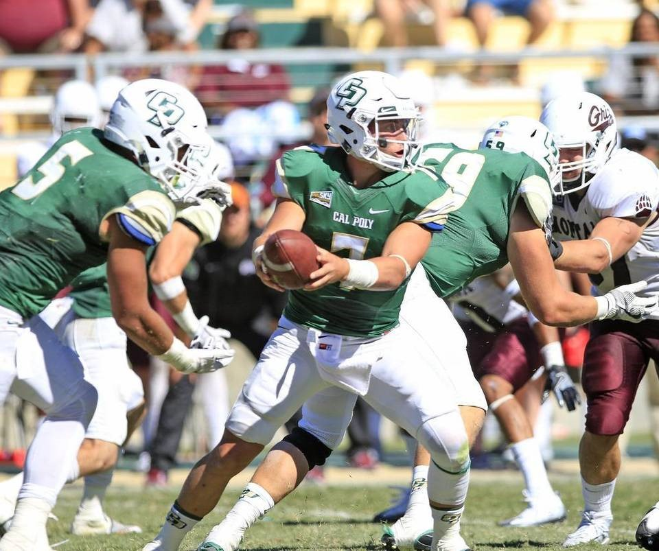 Cal Poly QB Dano Graves Handing off to FB Joe Protheroe (Laura Dickinson, San Luis Obispo Tribune)
