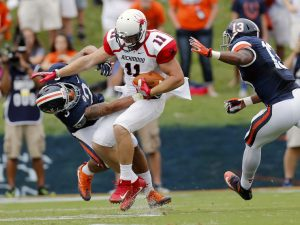 University of Richmond's Garrett Hudson (11) collides with University of Virginia's Quin Blanding (3) as UVA's Chris Peace (13) defends after a first quarter reception at Scott Stadium in Charlottesville VA Sat. Sept. 3, 2016. (Mark Gorman/Richmond Times-Dispatch)