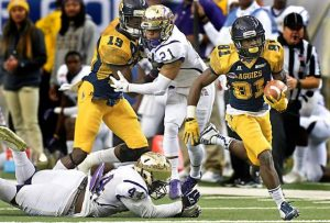North Carolina A&T running back Tarik Cohen (28) runs for one of his three touchdowns during a 41-34 win against Alcorn State in the Celebration Bowl at the Georgia Dome in Atlanta on Saturday, Dec. 19, 2015. (Hyosub Shin/Atlanta Journal-Constitution/TNS)