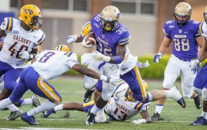 James Madison running back Khalid Abdullah (32) finds his way through traffic during the second half of an NCAA college football game at Bridgeforth Stadium in Harrisonburg, Va., September 19, 2015. (Daniel Lin/Daily News-Record)