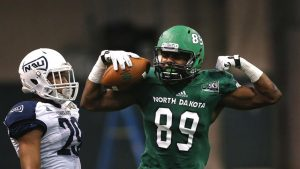 University of North Dakota wide receiver Demun Mercer (89) celebrates after completing  a pass for a University of North Dakota first down in the fourth quarter of Saturday's game against Northern Arizona University  at the Alerus Center in Grand Forks, N.D. (Jesse Trelstad/Grand Forks Herald)